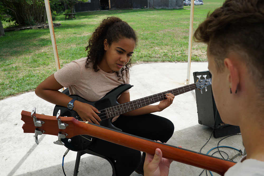 guitar lesson at kids camp