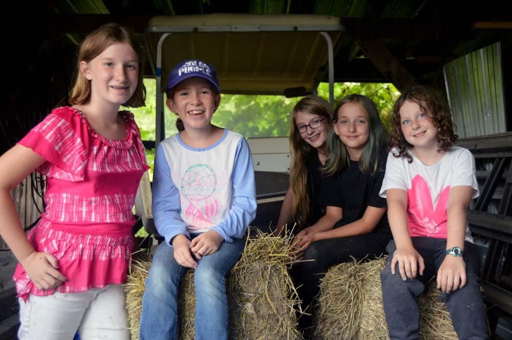 arts camp kids on hay
