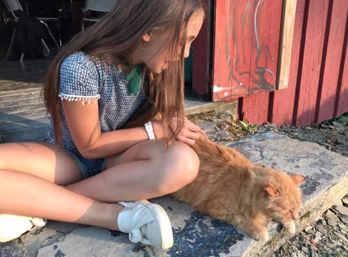 art camp camper with cat